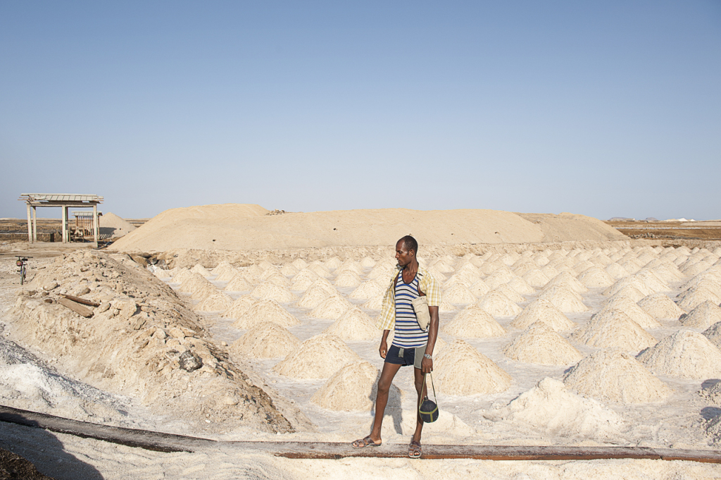 A worker in a salt pool at lake Afrera