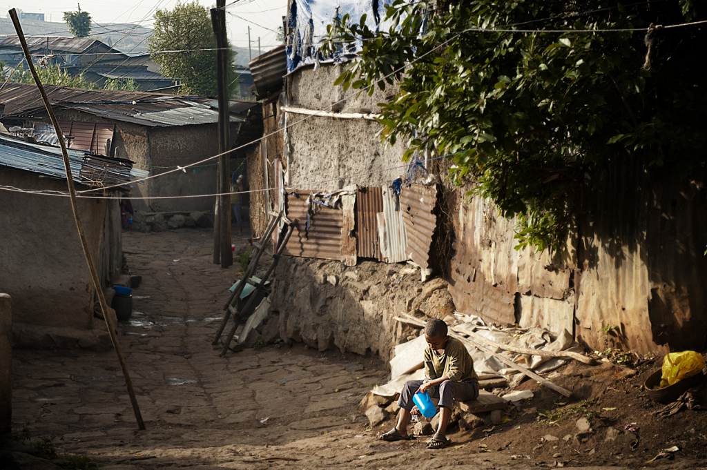 Daily cleaning in a Piassa informal settlement, which will be cleared soon