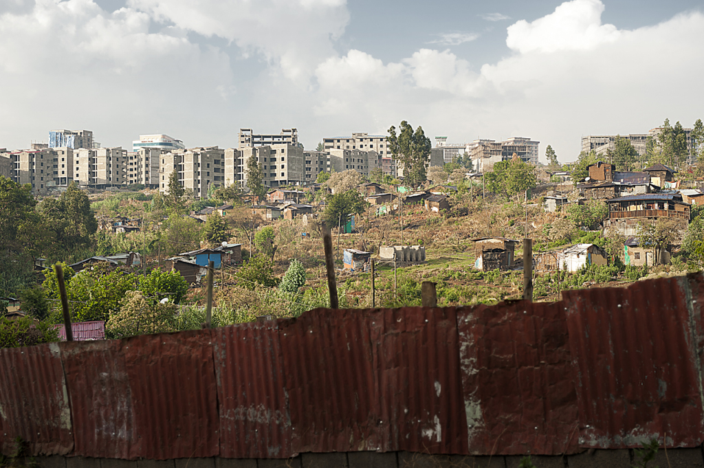 Informal settlement cleared at Piassa. In the back the new condominiums. Government has built 170,000 new housing units just in Addis, and 205,000 more are planned in the next 2 years