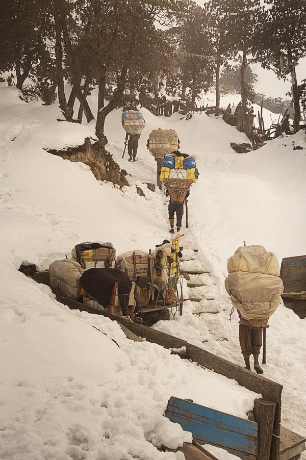 a-group-of-sherpa-climbing-lamajura-la-under-a-snowfall-everest-base-camp-trek