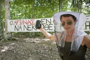 Fotevany during a Nogold activists camp. In her hand the honey she produces from Skouries forest