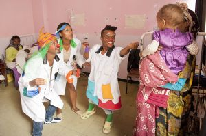 Fekat Circus artists performing The Smiles Projects at the Tukur Ambessa hospital