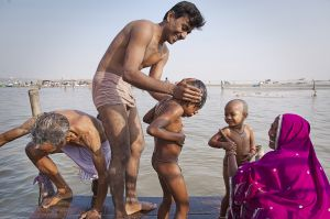 Hindu pilgrims at the Triveni Sangam, where Yamuna river and Saraswati (invisible) river join Ganges river