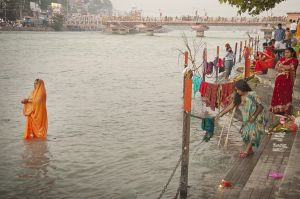 Praying into Ganges river at Haridwar