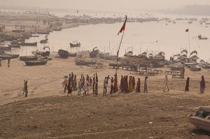 Pilgrims at the Triveni Sangam, where Yamuna river and Saraswati (invisible) river join Ganges river