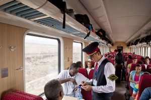 Chinese guard checks tickets on the Addis-Gibuti new train