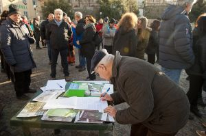 Rally participants signing the petition to free the monastery from Dhi